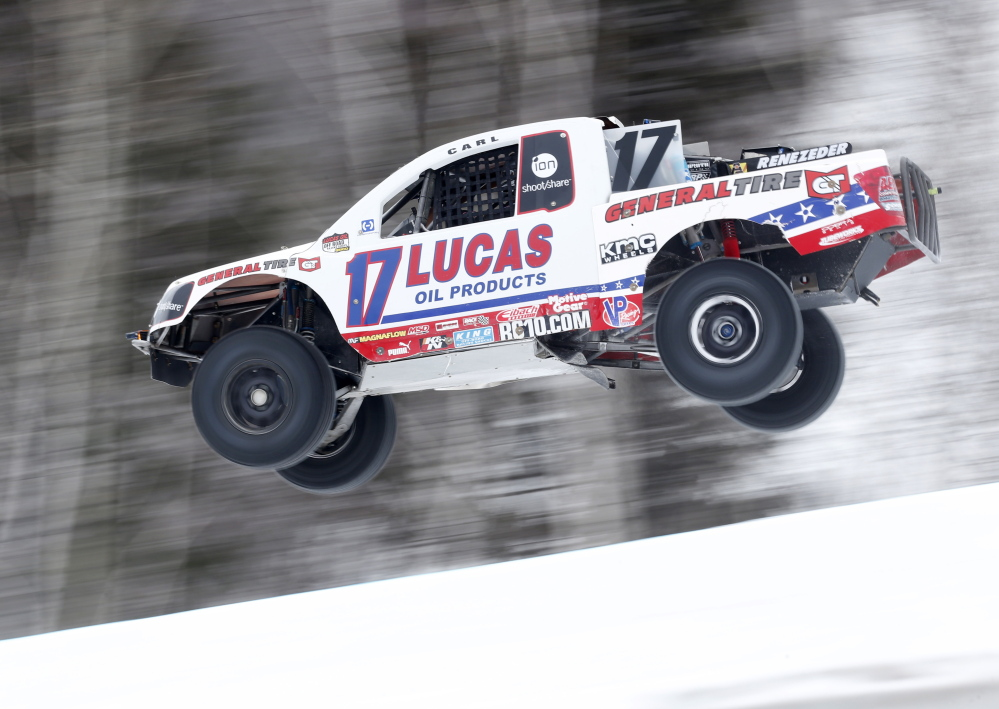 Carl Renezeder of Laguna Beach, Calif., sails over a jump while racing in the Red Bull Frozen Rush short-course off-road truck race, Friday, Jan. 10, 2014, at the Sunday River ski resort in Newry, Maine. The cold weather race was the first ever of its kind for the Baja racers.