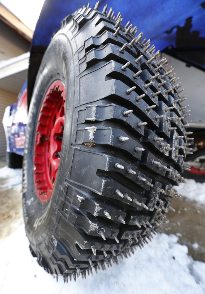 Studs protrude from a tire of a truck at the Red Bull Frozen Rush truck race Friday at Sunday River. The trucks reached downhill speeds of 95 mph while competing on the slopes of the ski resort and thrilling thousands of spectators. The race will be aired on NBC before the Super Bowl on Feb. 2