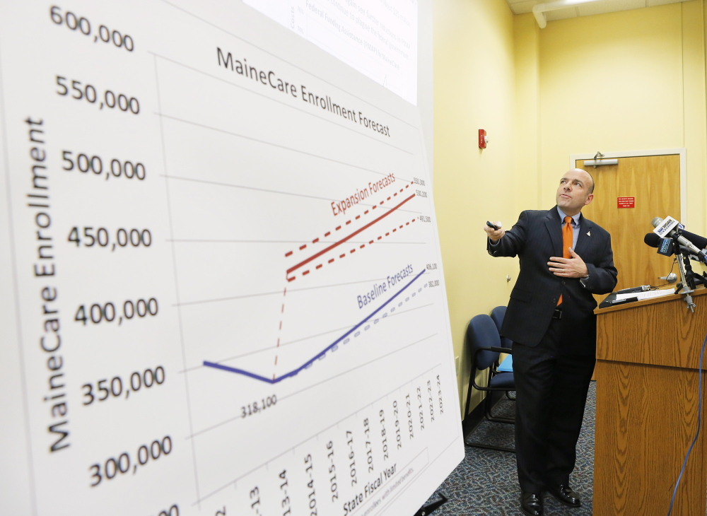 Gary Alexander of the Alexander Group presents his analysis of a report his group developed regarding the cost of expanding MaineCare at the Department of Health and Human Services in Augusta on Friday, January 10, 2014.