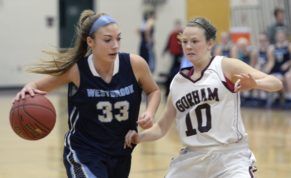 Westbrook's Alisha Aube drives against Jessica Rexrode of Gorham. Aube led Westbrook with 14 points.