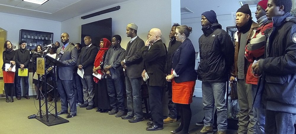 Dozens of Mainers address media and state officials Friday at the State House Welcome Center in Augusta. Immigrants, attorneys, religious leaders and advocates for the poor spoke in opposition to a proposed change to General Assistance.