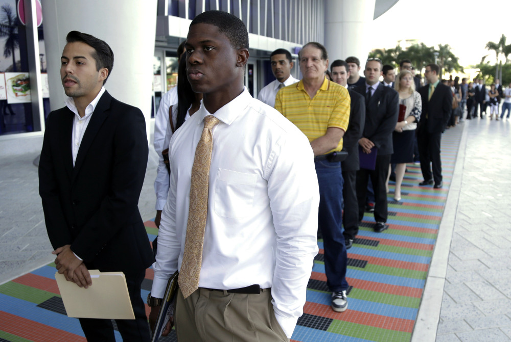 Job seekers like these in Miami did not have a lot of success in December, following four straight months of fairly strong hiring and an overall trend of a growing U.S. economy.