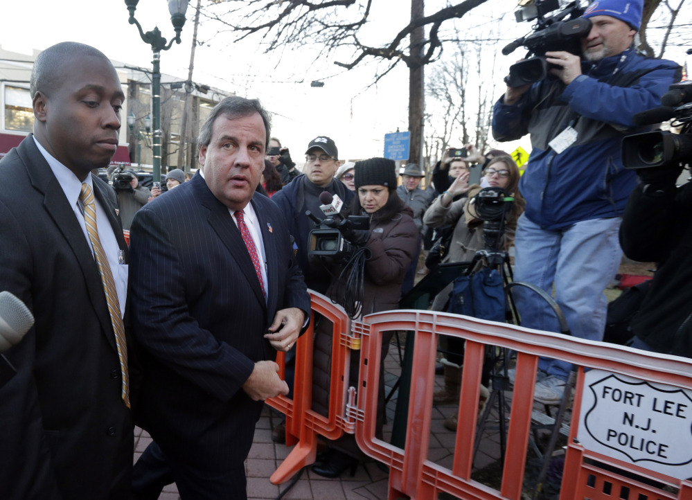 New Jersey Gov. Chris Christie, second left, arrives at Fort Lee, N.J., City Hall on Jan. 9. Christie traveled to Fort Lee to apologize in person to Mayor Mark Sokolich.