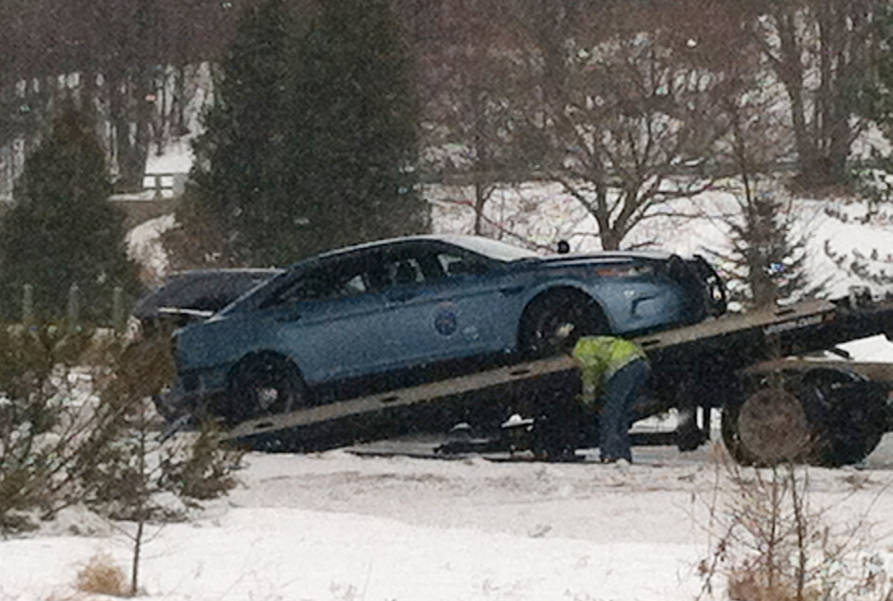 A Maine State Police trooper's cruiser is loaded onto a tow truck after the car was rear-ended on Interstate 295 Friday morning.