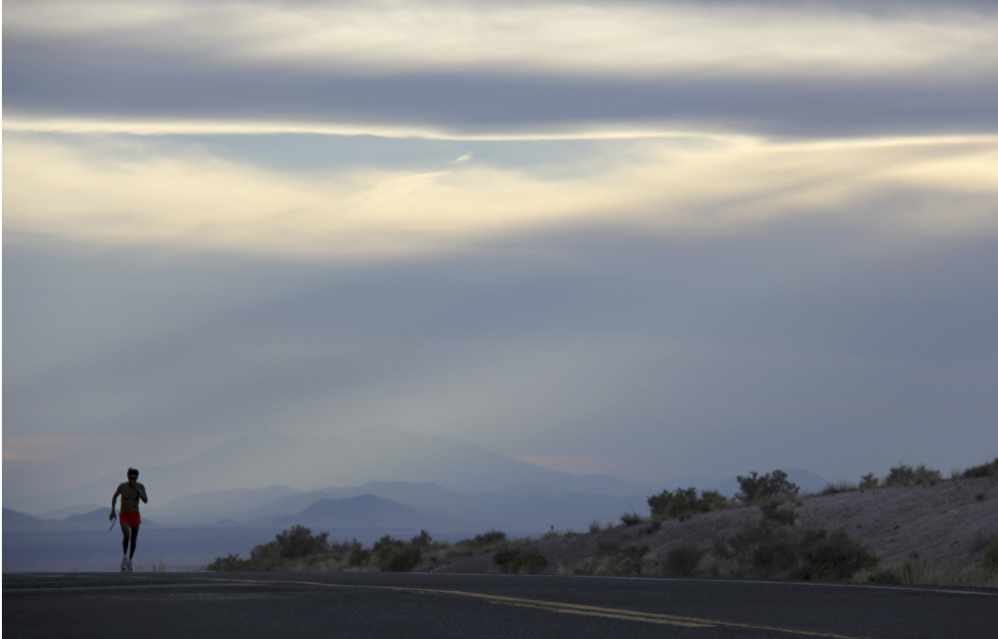 Thomas Hatathli runs along Indian Route 15 near Dilkon, Ariz., on June 12, 2013. Hatathli was one of more than 1,800 volunteers in a coast-to-coast run across the U.S. to help those affected by the Boston Marathon bombings in 2013.
