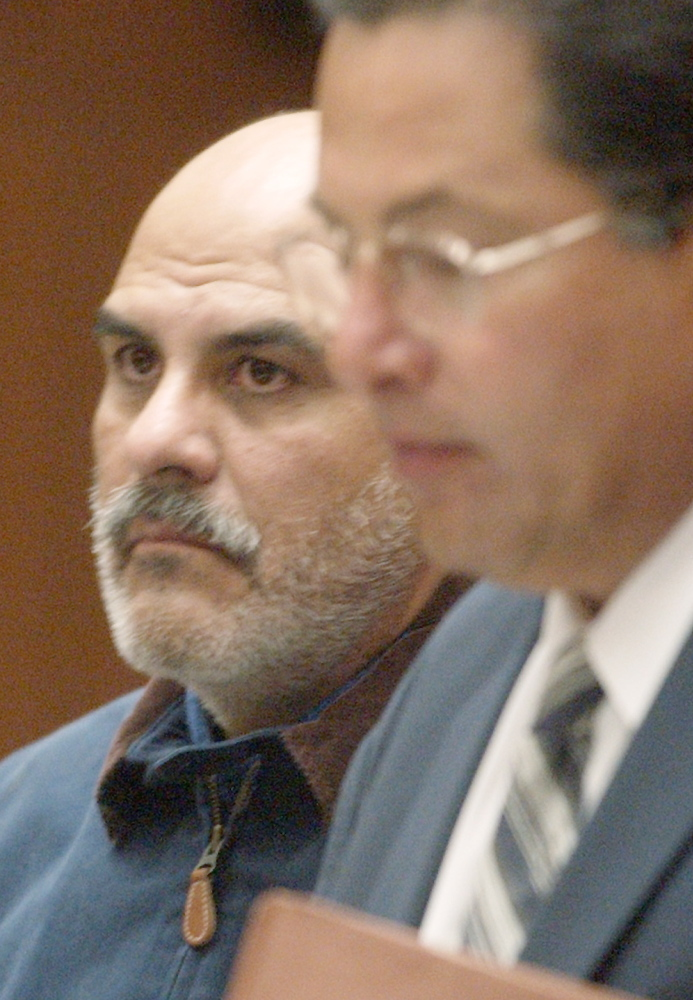 John Salazar, a former priest accused of sexually assaulting two boys in Los Angeles in the 1980s, appears with his attorney, Daniel Guerrero, right, for his arraignment in Superior Court in Los Angeles in this June 30, 2003, file photo.