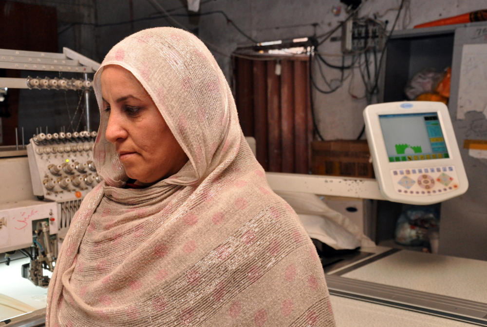 "Zarghuna Sherzad co-owns the Jahan Guldozi embroidery factory in Kabul, Afghanistan. ""I grew up in the war, and I've spent a very difficult time in the past,"" she said of the Taliban rule. ""I'm always praying that regime should not be repeated."""