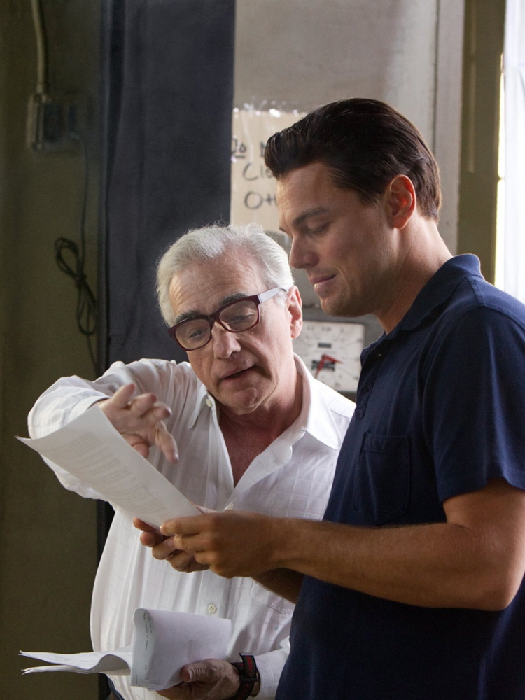 """Martin Scorsese directs Leonardo DiCaprio on the set of """"The Wolf of Wall Street."""""""