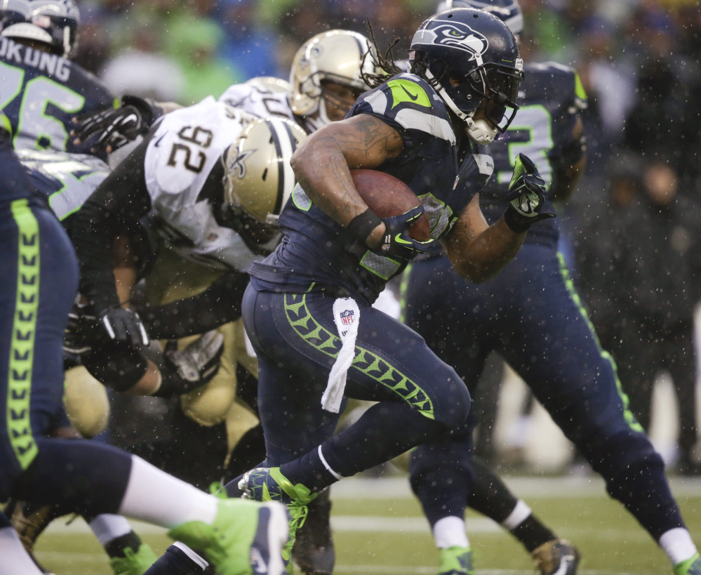 Seattle Seahawks running back Marshawn Lynch runs against the New Orleans Saints during the second quarter of an NFC divisional playoff NFL football game in Seattle, Saturday.