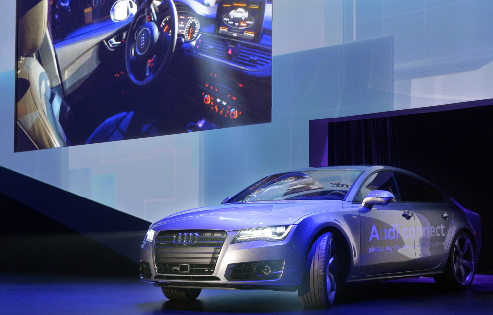 Audi's autonomous car drives on stage at the International Consumer Electronics Show on Monday in Las Vegas. The growing alliance between Silicon Valley and Detroit has executives in both places excited over the technological and money-making opportunities.