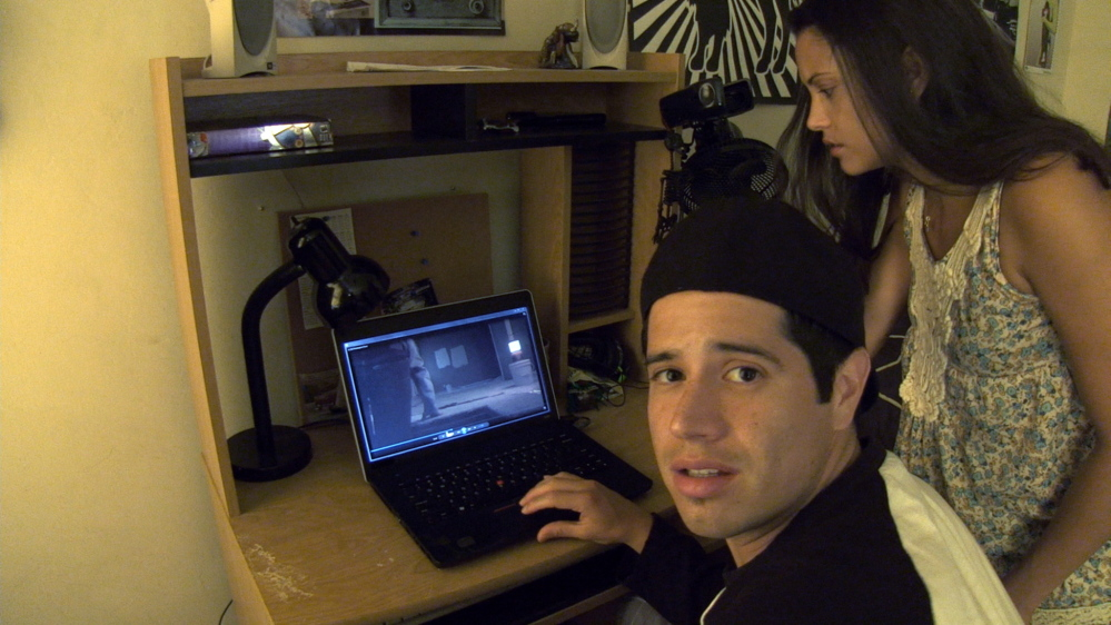 "Jorge Diaz and Gabrielle Walsh in a scene from ""Paranormal Activity: The Marked Ones."""