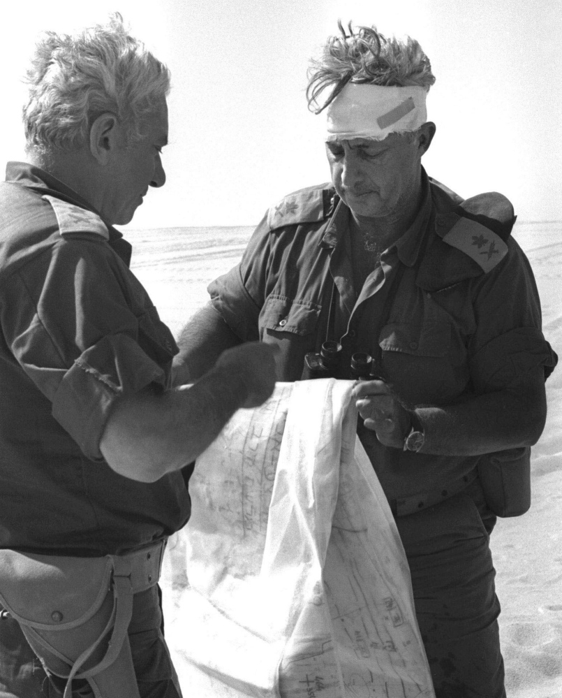 Maj. Gen. Ariel Sharon, right, views a map with Maj. Gen. Haim Bar-Lev in the Sinai desert during the 1973 Mideast war. Sharon, the Israeli general and prime minister who was admired and hated for his battlefield exploits and ambitions to reshape the Middle East, died Saturday. He had been in a coma since a debilitating stroke eight years ago.