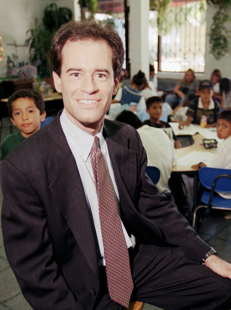 Ron Unz, shown in 1997, wants to raise California's minimum wage to $12 an hour in two steps.