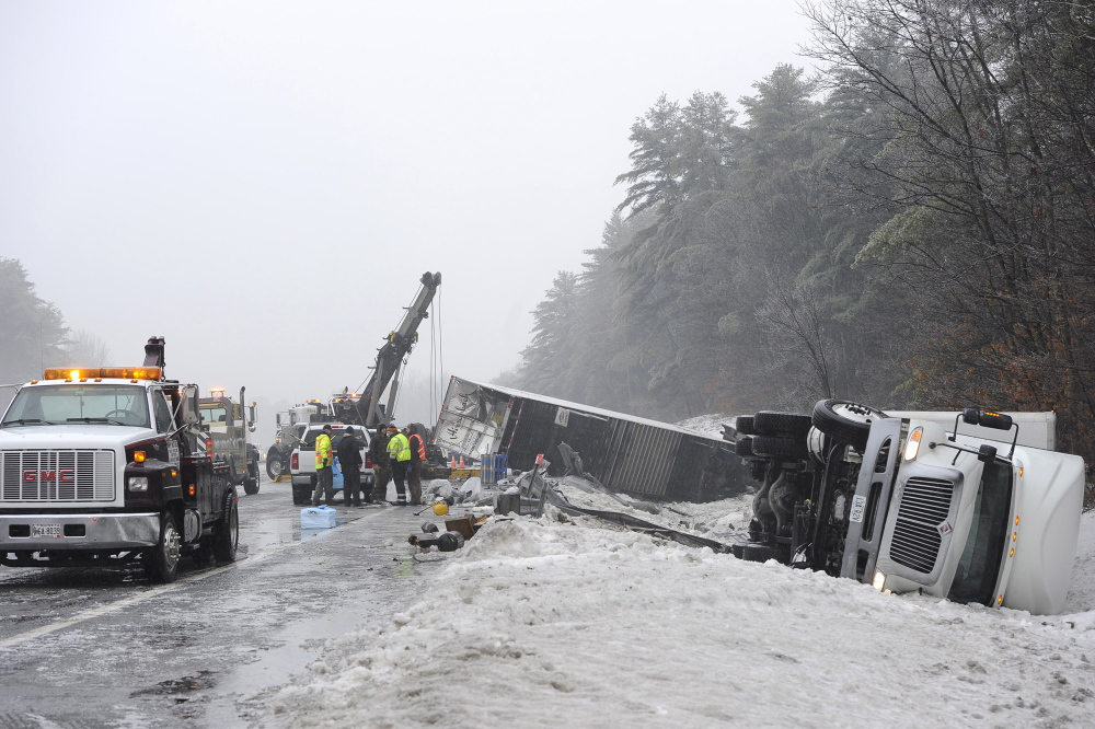 Tow trucks line up to remove four tractor-trailers that were involved in an accident on the Maine Turnpike in Falmouth on Saturday.