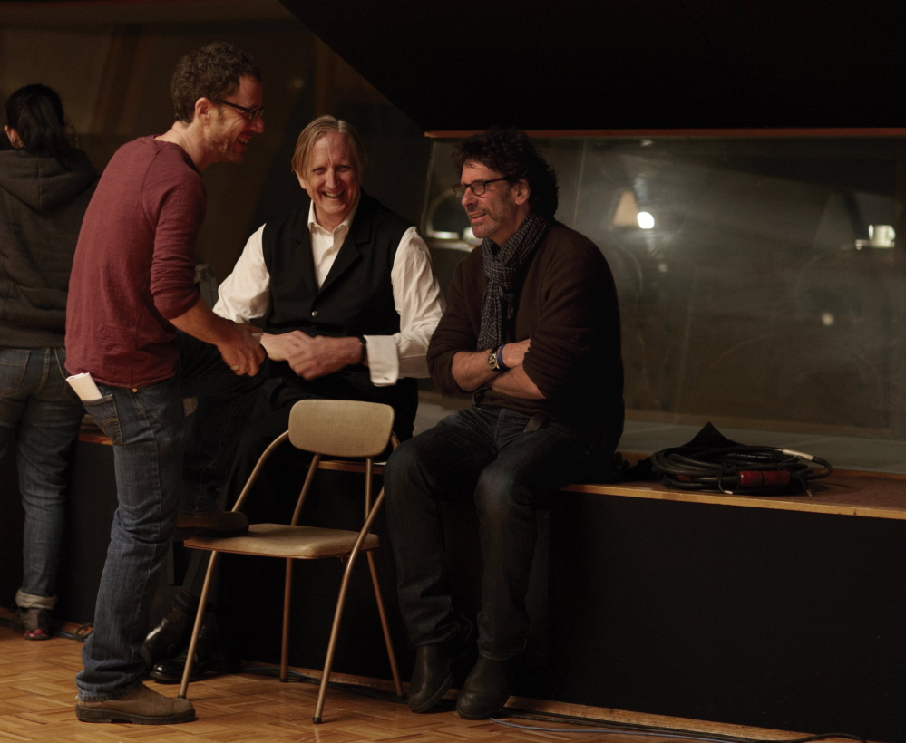 """Ethan Coen, left, T Bone Burnett and Joel Coen on the set of """"Inisde Llewyn Davis."""" The film marks a continuation of the musical relationship that the Coens have nourished with Burnett for years, beginning with """"The Big Lebowski"""" in 1998."""