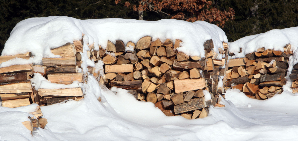 Stacks of wood are seen at the town transfer station in Hopkinton, N.H. Like a food bank, several communities in northern New England have set up wood piles for needy residents to get wood through the cold winters.