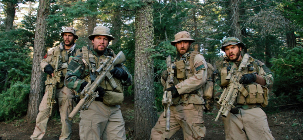 "A scene from ""Lone Survivor"" shows, from left, actors Taylor Kitsch, Mark Wahlberg, Ben Foster and Emile Hirsch. The film surpassed expectations at the box office."