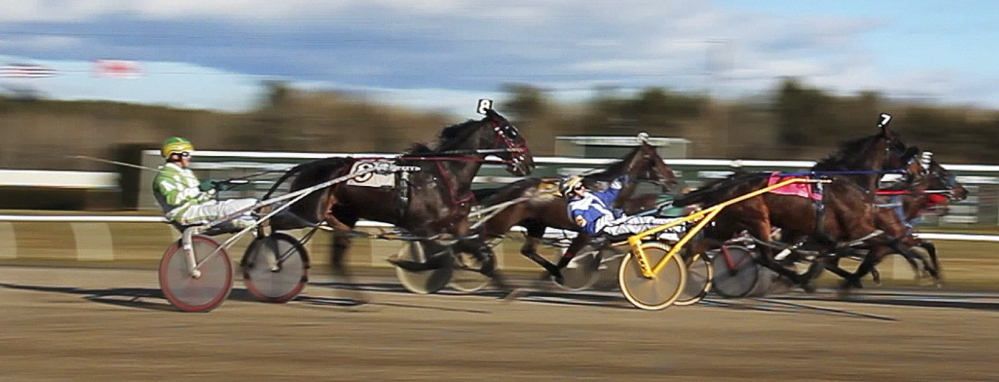 Horses cross the starting line during a race at Scarborough Downs in 2011. A bill under consideration would allow slots at the racetrack without approval by voters statewide.