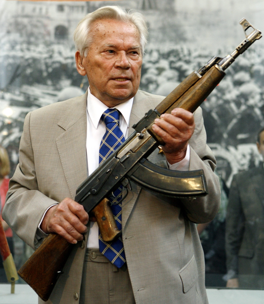 In this 2007 photo, Mikhail Kalashnikov holds a prototype of his famous AK-47 assault rifle at the Russia's Armed Forces Central Museum in Moscow.