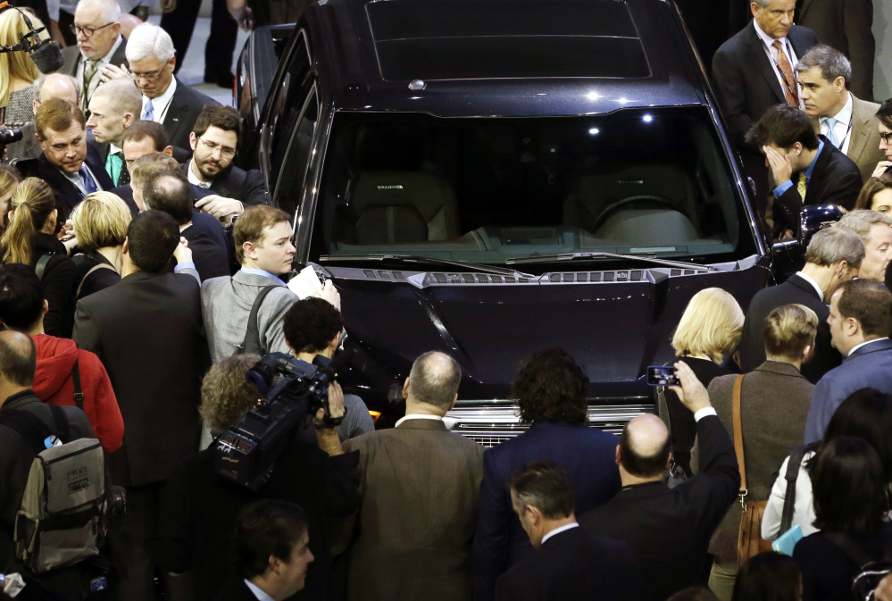 Journalists surround the new Ford F-150 at the North American International Auto Show in Detroit on Monday. The new pickup has a body built almost entirely out of aluminum.