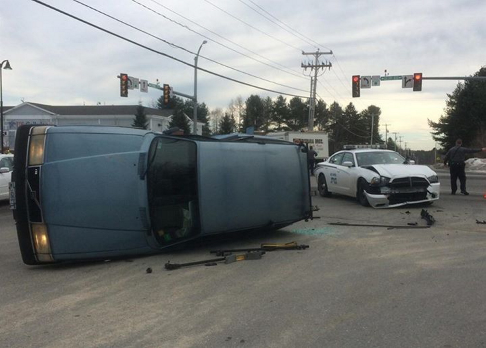 A Scarborough police officer and another driver suffered minor injuries in this crash at the intersection of Spring Street and Gallery Boulevard in Scarborough on Monday.