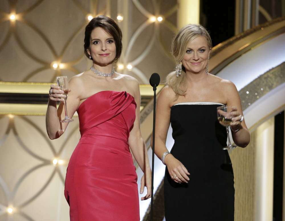 This image released by NBC shows hosts Tina Fey, left, and Amy Poehler during the 71st annual Golden Globe Awards at the Beverly Hilton Hotel on Sunday in Beverly Hills, Calif. Fey's zinger about George Clooney and his penchant for dating younger women may have been the most riotously received wisecrack in recent awards-cast history.