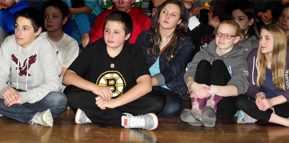 ANTI-BULLYING: Messalonskee Middle School students pay attention to an antibullying presentation by X Games medalist Kevin Robinson in Oakland on Monday. From left are Percy Carey, Blake Marden, Megan McQuillan, Sadie Colby and Addison Littlefield.