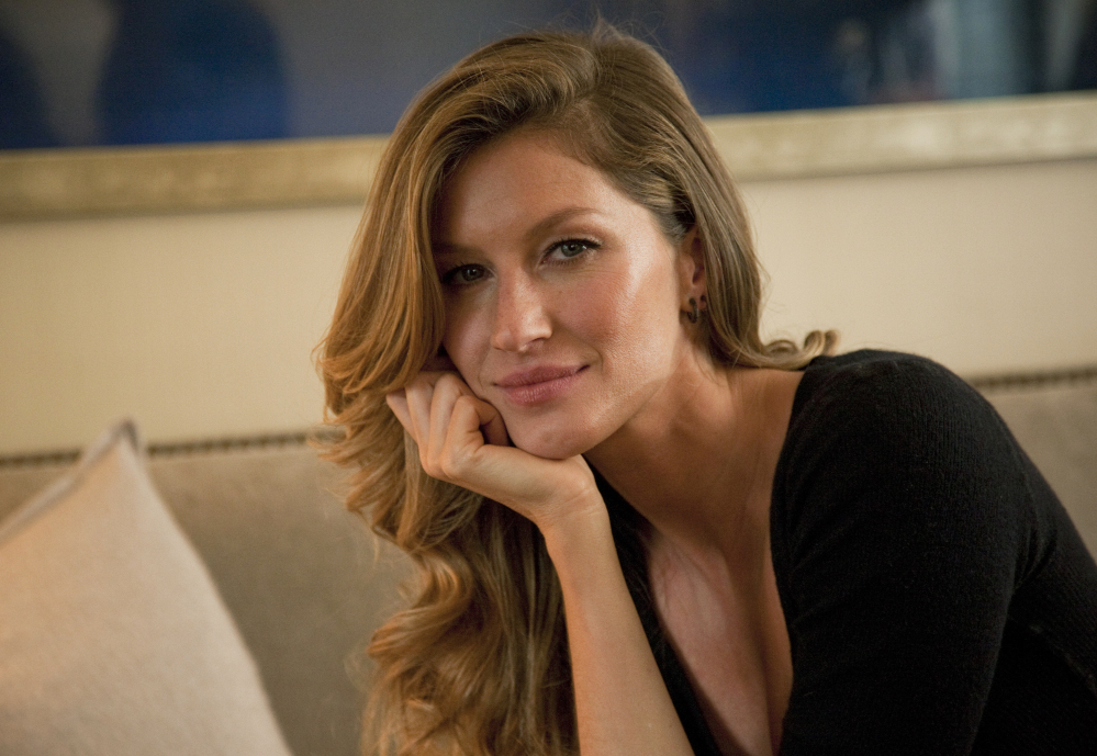 Gisele Bundchen is shown in January posing for a portrait in New York. Married to Patriots quarterback Tom Brady, Bundchen says the couple tries to keep job stress out of the house.