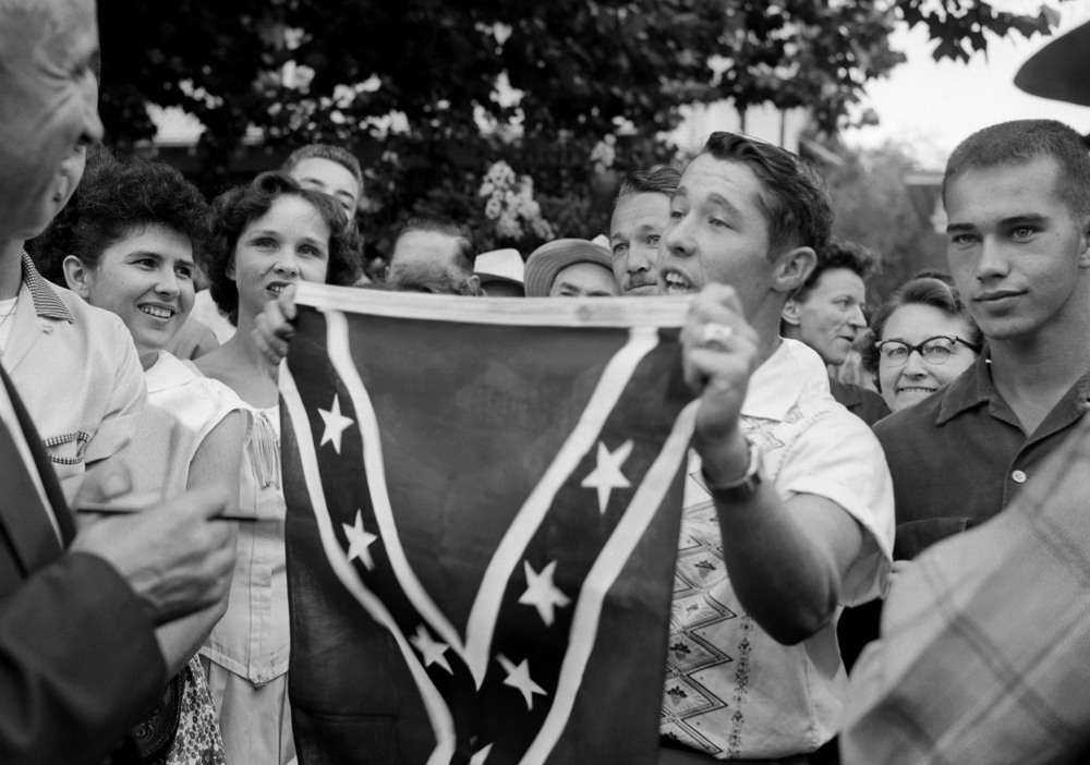 On Sept. 3, 1957, Paul Davis Taylor displays a Confederate flag in front in front of Little Rock Central High School.