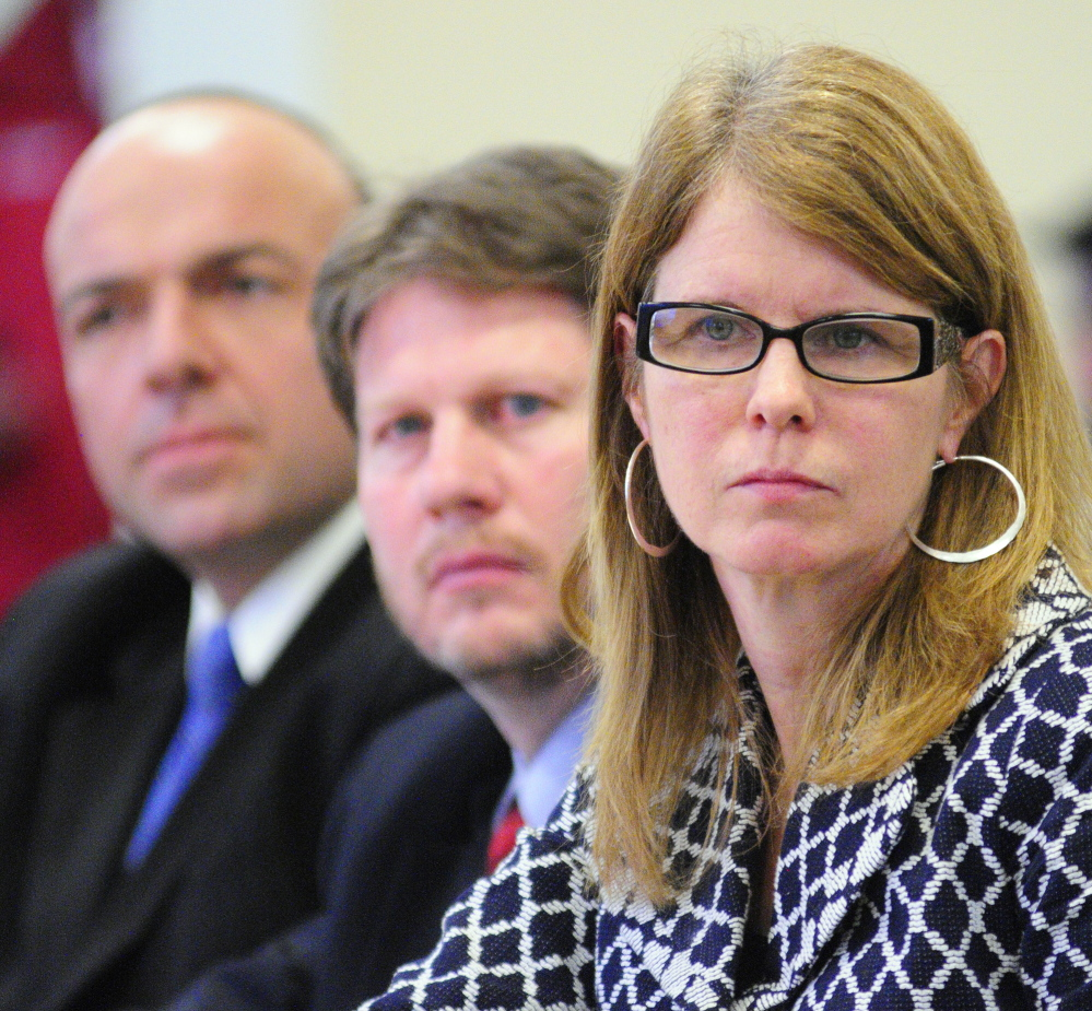 Alexander Group President Gary Alexander, left, senior associate Erik Randolph and Maine health and human services commissioner Mary Mayhew, listen at a legislative hearing Tuesday.