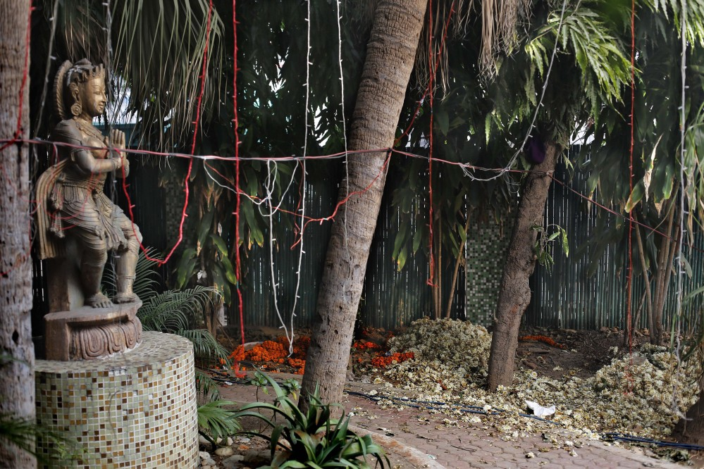 A statue stands at a spot that police say is where a 51-year-old Danish tourist was gang-raped in New Delhi, India. The woman managed to reach her hotel Tuesday evening and the owner called police.