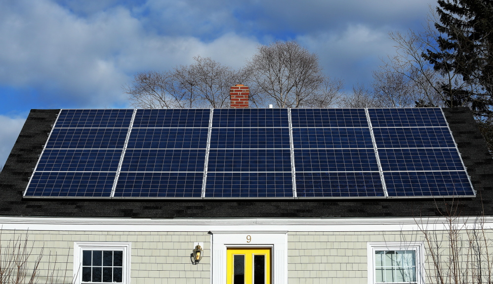 A solar panel array on the roof of a house on Lynda Road in Portland gathers sunlight last week.