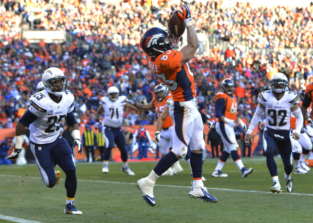 Wes Welker catches a pass for a touchdown against the San Diego Chargers in the AFC division playoff football game on Jan. 12, 2014.