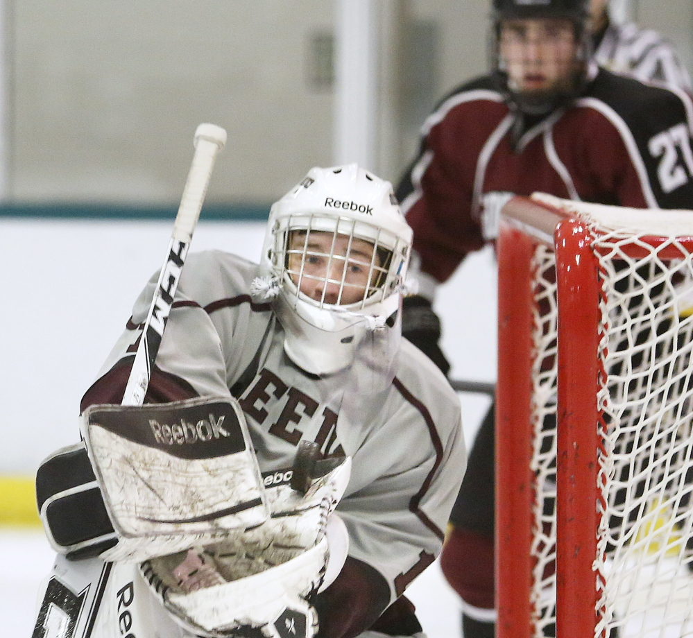 Christian Kroot of Greely makes a save Thursday night as Jared Wood of Gorham looks on during the second period of Greely's 2-1 victory. Kroot finished with 25 saves.