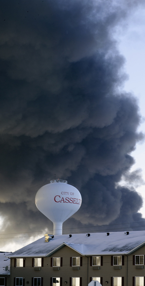 Smoke fills the sky above the site where a mile-long oil train derailed in Casselton, N.D., on Dec. 30.