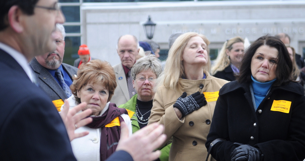 Carroll Conley Jr., executive director of the Christian Civic League of Maine, addresses supporters of L.D. 1428 on Thursday before a public hearing on the bill. He said a broad multi-faith coalition hopes to see the bill passed by the Legislature.