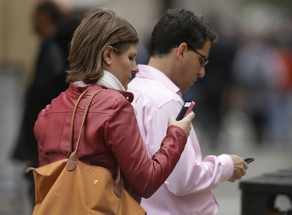 Pedestrians in San Francisco focus on their smartphones. Many admit they are secretly embarrassed about their smartphone bewilderment, and data show that only half of all American smartphone owners use the devices to access and send email.