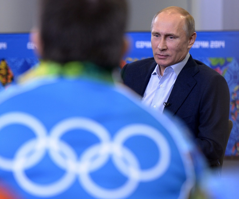 Russian President Vladimir Putin speaks during his meeting with a group of Olympic volunteers in the Black Sea resort of Sochi, Russia, on Friday.