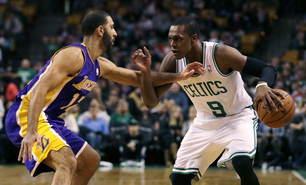 Boston's Rajon Rondo tries to drive past Los Angeles Lakers point guard Kendall Marshall during the first quarter of Friday's game in Boston. Rondo collected eight points and four rebounds in 20 minutes, but it wasn't enough as Boston lost again.