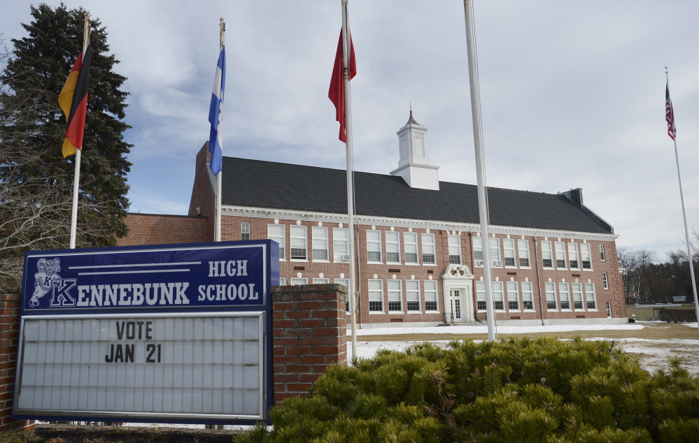 A sign in front of Kennebunk High School reminds voters of the Tuesday referendum.