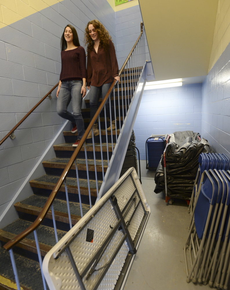 Kennebunk High School students Sam Abelson, left, and Katelyn Hurlburt walk down a stairwell. Proposed renovations to the high school alone are expected to cost $53.5 million and include a stand-alone performing arts building.