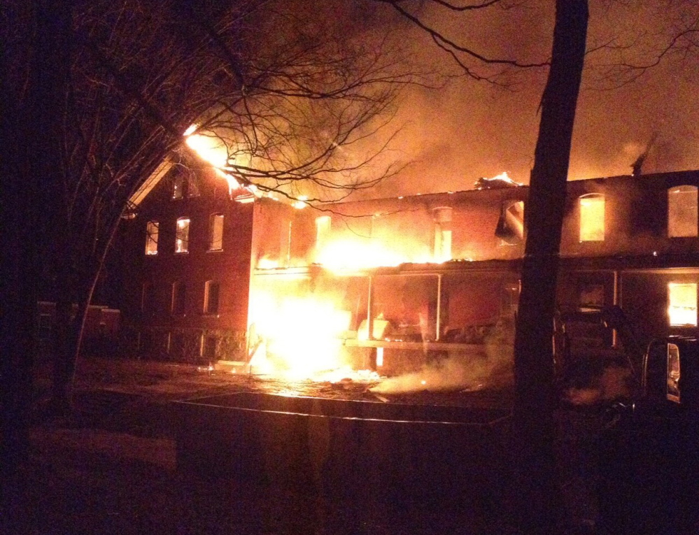Flames engulf the historic Fort McKinley building on Great Diamond Island on Nov. 23, 2013. The early morning fire was spotted by the tender of the Casco Bay Bridge, who reported seeing a glow from the island.