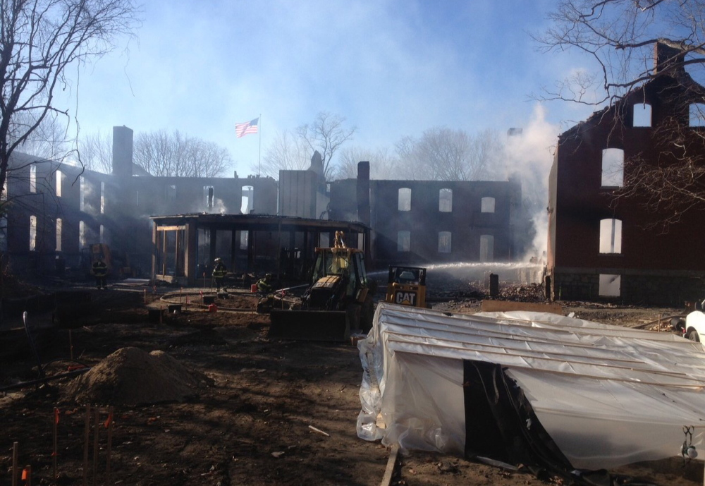Smoke rises from historic Fort McKinley on Portland's Great Diamond Island on Nov. 23, 2013. The developer expects the rebuilt Inn at Diamond Cove will be ready to open in May 2015.