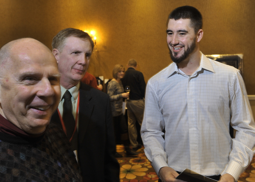 Red Sox pitcher and former Sea Dog Brandon Workman chats with fans prior to Friday's Hot Stove Dinner and Silent Auction at the South Portland Marriott. Workman started last season as a Sea Dog and ended it as a member of the World Series champions.