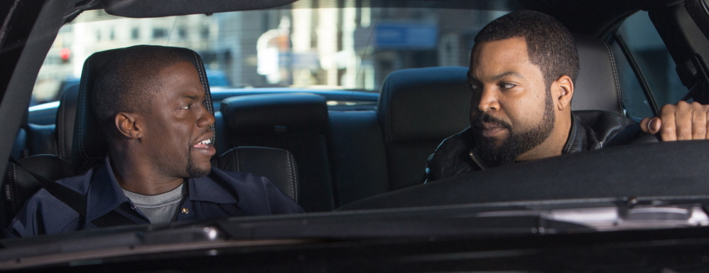"""Kevin Hart, left, plays a would-be police officer and Ice Cube a surly veteran cop in """"Ride Along."""""""