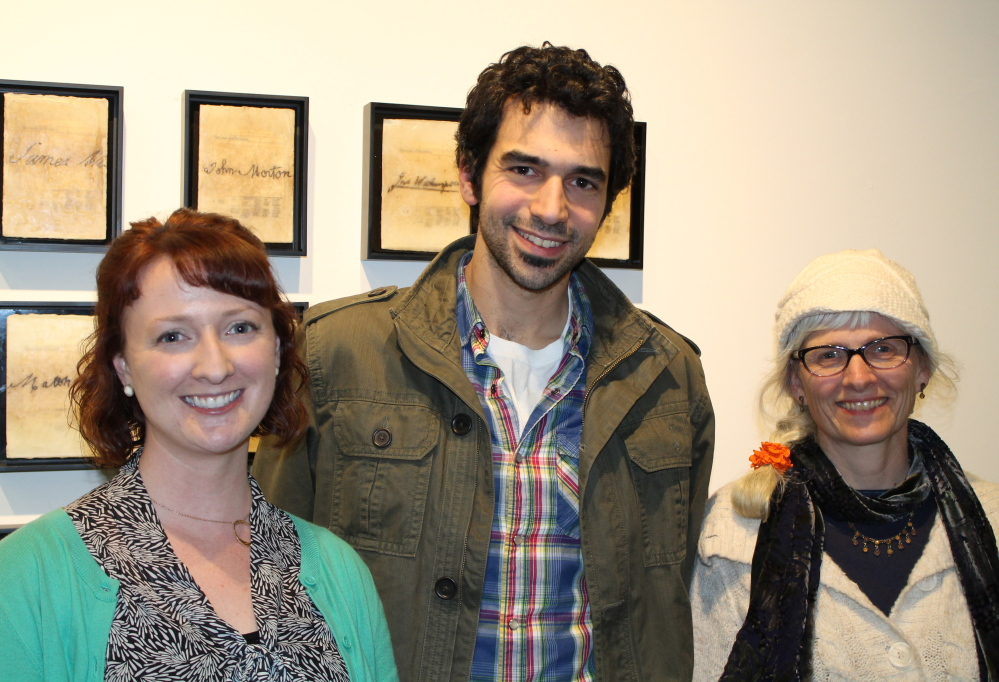 Erin Bartoletti, coordinator of arts promotion at the University of Southern Maine, with artist Tyson Jacques, USM alum and Best of Show award winner, and Carolyn Eyler, director of exhibitions and programs at USM.