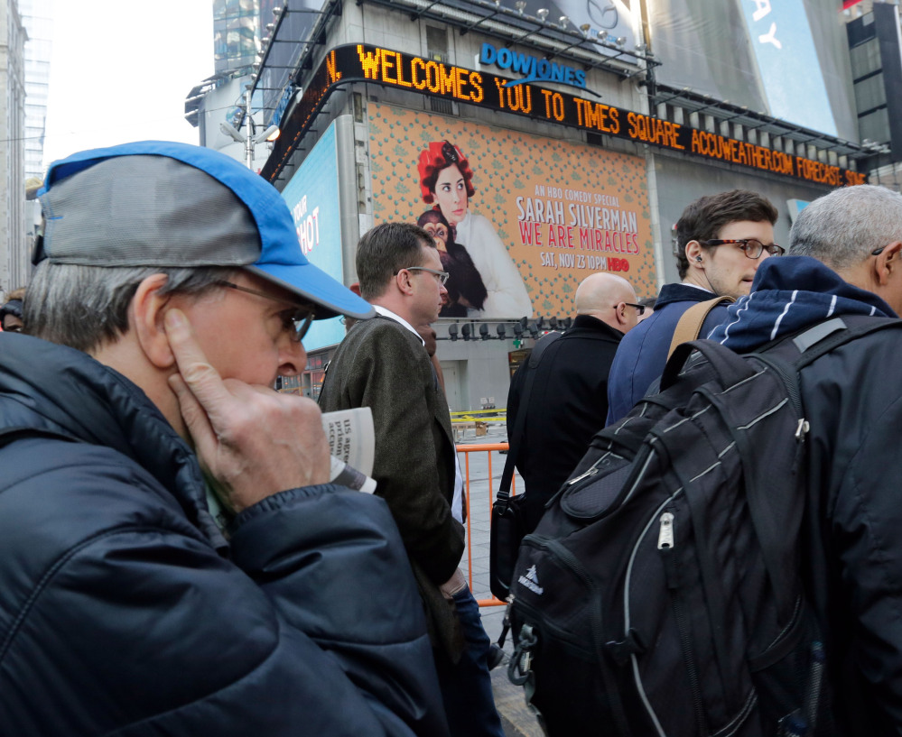 A pedestrian covers an ear in New York's Times Square. A New York City hotline received more than 260,000 calls complaining about excessive noise, despite the fact that the city has one of the toughest noise codes in the nation and stiff fines for noisemakers.