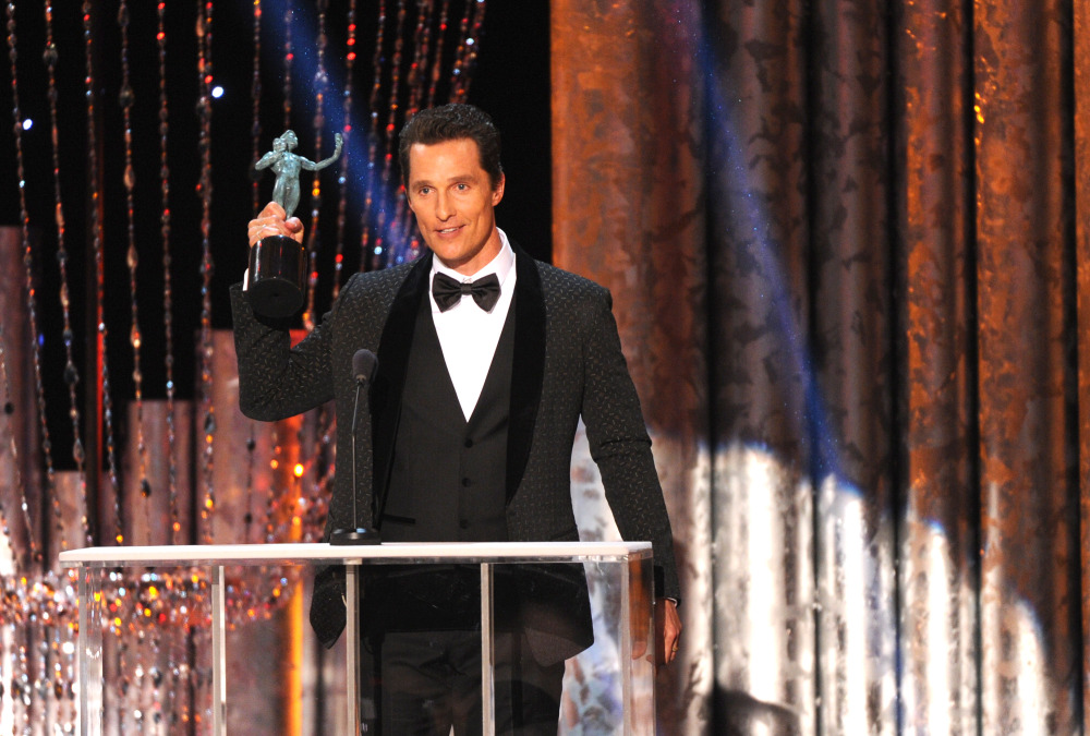 """Matthew McConaughey accepts the award for outstanding performance by a male actor in a leading role for """"Dallas Buyers Club."""""""