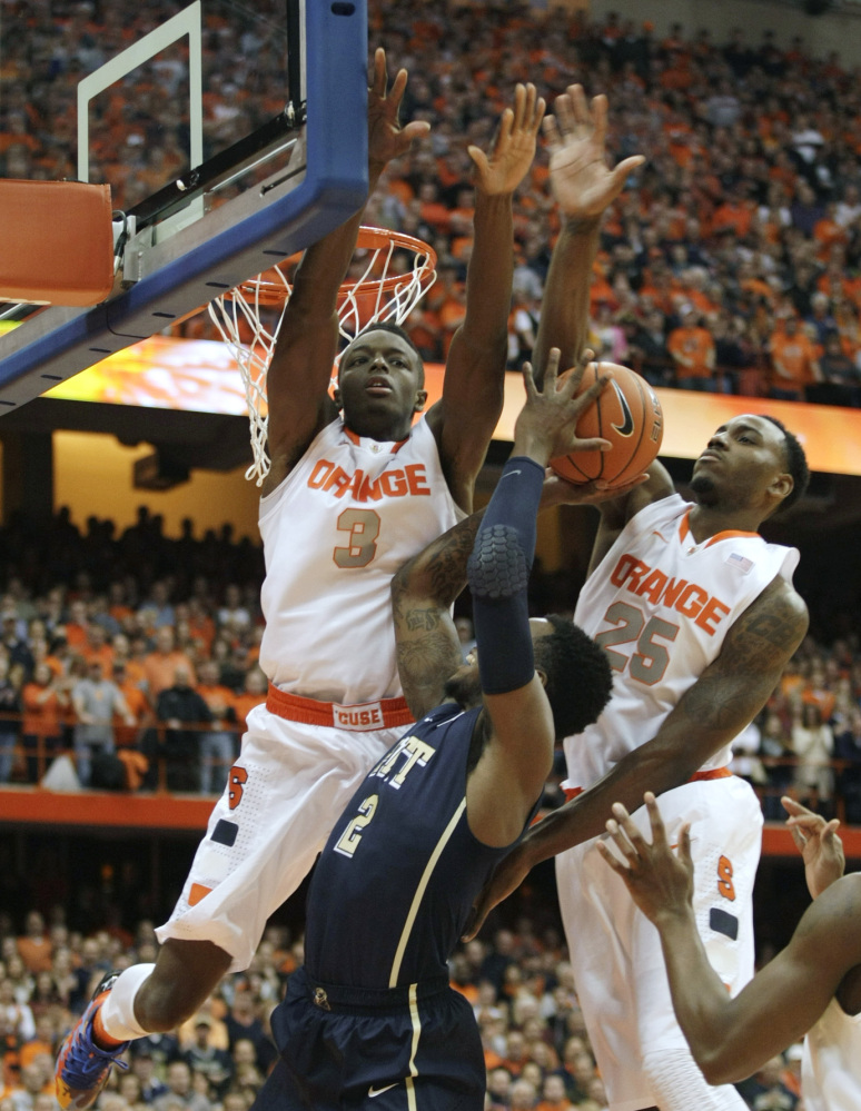 Syracuse's Jerami Grant, left, and Rakeem Christmas put pressure on Pittsburgh's Michael Young in the first half of Saturday's 59-54 Syracuse victory.
