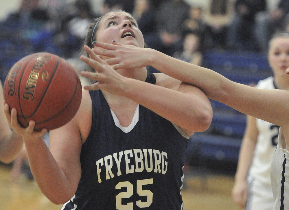 Skye Dole, who had 13 points, nine rebounds and three steals for Fryeburg Academy, looks for her shot after pulling down an offensive rebound against Yarmouth.